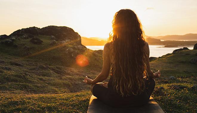 spiritual direction woman meditating sunset