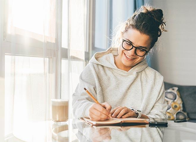 writing coaching woman writing in journal